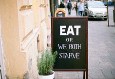 """""""Eat or we both starve"""" restaurant sign!"""