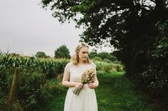 Bride wears a capped sleeved lace dress   Photography by http://www.lukehayden.co.uk/