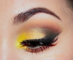 This striking combination of black and yellow by ohsojess is aptly named 'Honey Bee'. To achieve the look, she used Makeup Geek's eyeshadows in Chickadee, Corrupt, Gold Digger (foiled), Mocha, and Frappe.