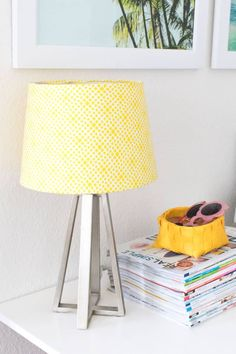 This DIY lampshade makeover takes less than 30 minutes and it's incredibly easy to do! Get creative with your fabric covered lampshade. Style for vintage or farmhouse decor.