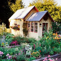 Carefree Cottage Style:  A playful profusion of flowers, whimsical sculptures, and found objects set the tone for a practical but lighthearted approach to gardening. An ample storage shed with a sun-drenched potting-shed annex makes maintaining the garden a snap.