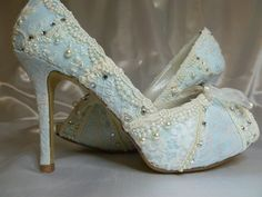 Something Blue ...baby blue lacey wedding shoes..you choose the style and height.. $275.00, via Etsy.