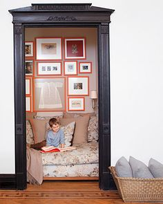 Put moulding around a closet, remove the door; add lights and comfy seat with pillows- a unique and special reading nook! - Refer to Young House Love for a closet/reading nook combo.maybe I could do this for that little closet in the living room Style At Home, Reading Nook Closet, Closet Nook, Closet Space, Hallway Closet, Closet Library, Closet Redo, Front Hallway, Door Entry