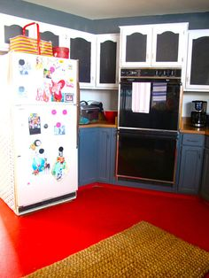 Red painted concrete floor..too bright. But the blackboarded cabinets work. And the lower cabinetry color vs. upper.