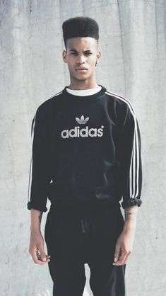 The Adidas trefoil and triple stripe signals sportswear due to the brands grounding in that particular area of the industry. As a graphic in sportswear, logos symbolise an athletic influence. Credit: unknown