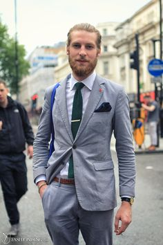 London! Great classic color combination of a grey cotton suit with green knit tie & navy pocket square. Get yours at www.peacon-munich.com