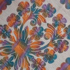 Hawaiian quilting - these are such gorgeous quilts.  love the colors!