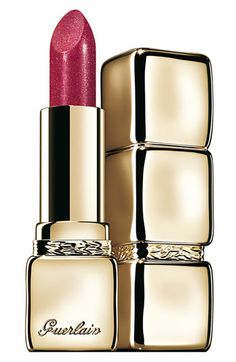 Kiss Kiss Strass reveals sparkling and extra-scintillating shine. Sexy and glamorous, this ultimate accessory of seduction plays with dazzling reflections to multiply light like a kaleidoscope. Ten shimmering and sparkling shades in three different families: the Red Gold family, the Yellow Gold family, the Pink Gold family.  By Guerlain.