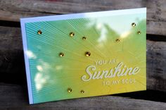 witticisms: Hello, Sunshine - So in love with this! Love the sentiment on the clear cardstock with the bling over that gorgeous background.
