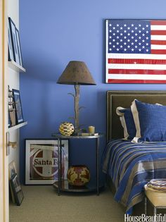To coordinate with the flag in this Santa Fe, New Mexico, bedroom — a gift the homeowner received after making a speech in Washington — designer Emily Henry painted one wall in Enchanting Sky by Dunn-Edwards.   - HouseBeautiful.com