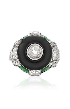 Van Cleef & Arpels - An Art Deco diamond, onyx and jade ring.