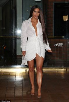 Wow factor: Kim Kardashian put her cleavage and legs on full display as she arrived for he...