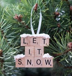 Add the title of your favorite Christmas tune to your tree by using Scrabble tiles as a unique ornament.
