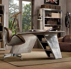 """Aviator Wing Desk"" from Restoration Hardware - Though not derived from a real aircraft, the aerodynamic look of the piece, combined with the rough-polished riveted aluminum construction, calls to mind the aircraft designs from the 1930's."