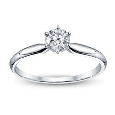 14k White Gold Round 1/2 Carat Brilliant Solitaire Engagement Ring. I'm a simple girl, so a simple yet stunning ring would be fine.
