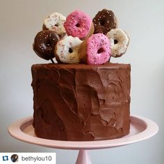 How adorable is this birthday cake made by our very own Beth Somers?  #Repost @bethylou10 with @repostapp. ・・・ 8 little doughnuts for my favorite 8 year old's birthday. Mini doughnuts made from marshmallows and Candy Melts. Thanks to @jennystreicher and @themarshmallowstudio for the sweet inspiration!  #doughnut #marshmallow #birthday #birthdaycake #cakecakecake #diy #homemade #baking @wiltoncakes