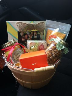 Georgia Theme Gift Basket  I made this for a friend who never gets to come home to Atlanta after moving far away. It includes Atlanta themed coasters (DIY Tiles), Peach gummies, Lemon Pound Cake Candle, Peanut Brittle, a picture frame of all her college friends, and a Nike gift card because she loves to run. Customized to perfection. :)