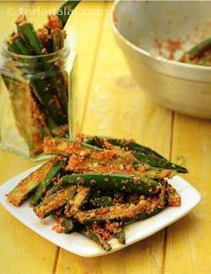 This is one of the rarer pickles, not seen often. Crisp ladies fingers coated with sesame seeds along with pickling spices and mustard oil.   Lemon juice added to the bhindi removes its stickiness and leaves it tart and crisp.  Serve it as soon as it is prepared to enjoy the clean and fresh flavours of this pickle.