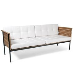 "HÄRINGE Lounge Sofa designed by CARL JÄGNEFELT & JOACIM WAHLSTRÖM, 2009 for SKARGAARDEN Made in teak with stainless steel frame. Cushions in white Sunbrella material. Dimensions 72""W X 28""D X 26""H Armrest Height: 28.4""; Seat Height:15.4"""