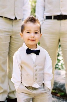 What a dapper little ring bearer! The khaki-coloured groomsmen suits are a perfect match for a summer wedding, too. Photography by Braedon Photography.