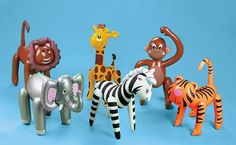 Jungle-Themed First Birthday Party inflatable animals from www.fabeveryday.com