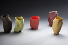 hand built with porcelain slip and mason stains. juice cups. Molly Bernstein