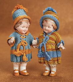 """German Factory-Original All-Bisque Dolls 5 1/2"""" (14 cm.) Each has one-piece bisque and torso,loop-jointed bisque arms and legs,with sculpted short curly brown hair and hair ribbon,b Marks: 10499. Comments: Gebruder Heubach,circa 1916."""