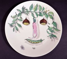 A Set of Six Piero Fornasetti Arcimboldesca-Motif Vegetable Face Plates