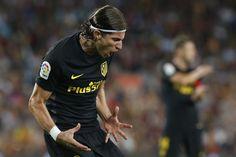 Atletico Madrid's Brazilian defender Filipe Luis shouts after missing a goal…
