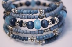 I just love a bracelet that goes great with jeans and this one definately does. Beautiful blue denim colors surround this entire bracelet. I made 2 bracelets, you have a choice of a dragonfly charm or butterfly charm, please specify when ordering.  I made this using various shades of beautiful blue, glass seed beads accompanied by wood beads and pretty silver plated spacer beads and silver lined glass seed beads. I have one bracelet available with a pretty, silver plated dragonfly charm and…