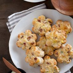 Bacon, Gruyere & Green Onion Scones Recipe Breads with all-purpose flour, granulated sugar, baking powder, baking soda, salt, butter, bacon, gruyere cheese, green onions, cracked black pepper, buttermilk, heavy cream