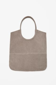 Made from soft unlined suede, this large shopper-style bag has rounded handles that can also be worn over the shoulder. Inside, it has a single main compartment and an attached leather coin purse.