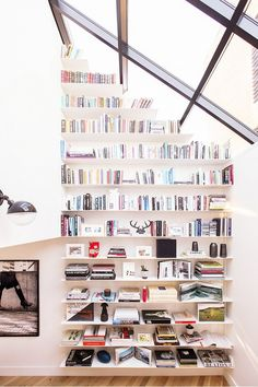 Dining room with a floor to ceiling wall of books