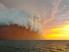 Jan. 11, 2013: A cloud formation tinged with red dust travels across the Indian Ocean near Onslow on the coast of Western Australia. (© Brett Martin/fishwrecked.com/Reuters)