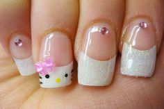 Enjoy this fresh looking hello Kitty white and clear French tips that are very cute and adorable. Perfect for an everyday do. Each nail is them coated with clear polish to keep the design from being destroyed. Small accents of beds and bows are also added for a better effect.