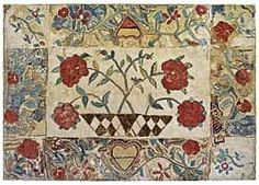 The exceptionally large nineteenth-century floral rug mounted on the side wall of the family room was purchased from Collette Donovan.