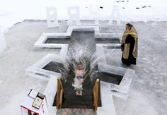 A man falls into the icy waters of a lake as part of celebrations for Orthodox Epiphany in Minsk, Belarus. | (REUTERS/Vasily Fedosenko)