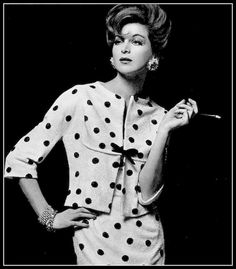 Model in cocktail dress and jacket of tiny pearlized crystal crépe fabric appliqued with black polka dots by Jean Dessès | Photo by Georges Saad, 1962