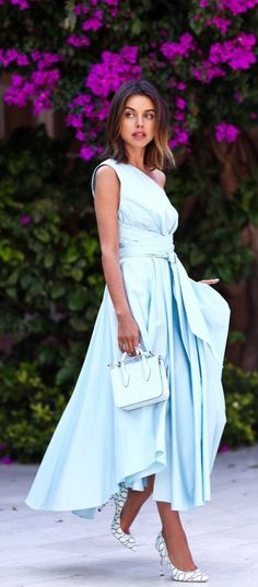 We're head over heels in love with this light blue Tibi one-shoulder wrap dress.
