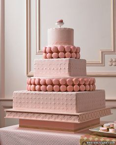 Macaron Wedding Cake    A majestic design turns a bit coquettish when it's festooned with macarons -- the quintessential French treats -- and dressed up in flirty pink. Homemade marshmallows cut into rounds echo the shape of the raspberry macarons, as does the pattern on the fondant.