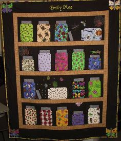 """Really cute """"bug jar"""" quilt, <3 the child's name embroidered on the head and the black boarders."""