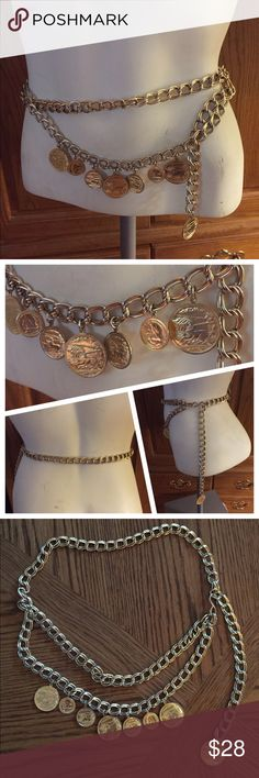 """VINTAGE GOLD CHUNKY CHAIN COIN WAIST HIP BELT This great Gold-Tone Chunky Chain Belt had a draping chain holding 7 faux Coins. The larger Coins feature Alexander the Great on the front and a 3-horse drawn chariot/chariot racer on the back. Measures 36"""" in total length and can be hooked to be shortened accordingly. A 1-1/4"""" diameter coin hangs from the dangling chain after it is hooked. In excellent preowned vintage condition. Vintage Accessories Belts"""
