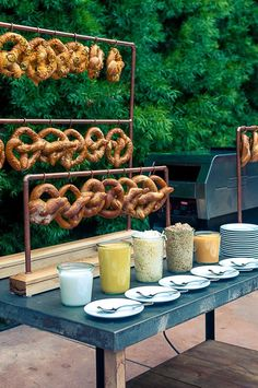 Pretzel bar for Oktoberfest party Oktoberfest Party, Wedding Pretzels, Wedding Food Stations, Drink Stations, Coffee Stations, Pipe Decor, Soft Pretzels, Mustard Pretzels, Wedding Catering