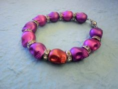 Metallic pink and Purple skulls bracelet