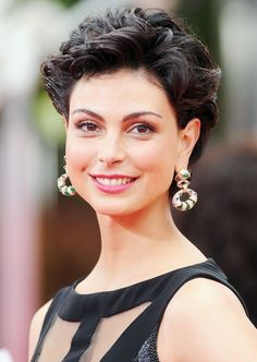 The consummately immaculate actress Morena Baccarin never fails to impress with her hair, dress, and matching accessories at celebrity events. Shown here at the 69th Annual Golden Globe Awards, her hair is cut short and curled in a crop of back curling black hoops. Parted with the fingers just slightly off of the center, her …