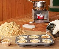 Firestarters: Pack sawdust into paper muffin cups.  Melt paraffin wax or old candles in a double boiler, pour over the sawdust and allow to cool. Slow-burning when lit, these hotcakes make great starters for a fireplace or campfire. I think they'll make great Christmas gifts for the outdoor enthusiasts.