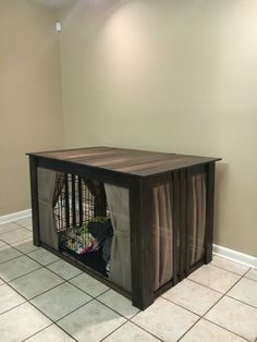 "Dog crate cover! We made it from unfinished pine wood from Home Depot. Stain color ""Kona"""