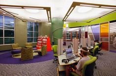 Teen library space- They are starting to all look alike. This has a good drop ceiling idea though. More intimate. Perhaps it's because we all order from the same suppliers. How about something a little more grown up for the high school crowd.