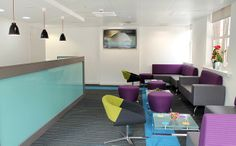 Jewel tones of teal and purple against slate grey. Impressive office space in Manchester city centre.