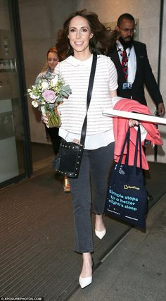 New mum chic: Smiling Alex Jones struts out of the BBC showcasing her sleek post baby figu...